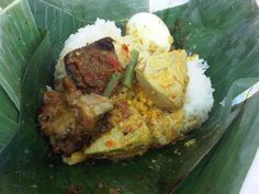 Nasi bungkus ( Rice wrapped in bananaleaf with little bits of sidedishes. good for lunchtime