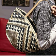 #Navajo -inspired, this #handwoven #tote of #abaca fiber in natural, brown and black hues is rich in pattern and texture. Can you feel it as you gaze upon it? Include in our launch collection?? Vote yes or no please!