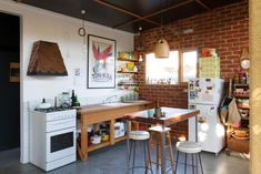 Warm open kitchen with freestanding furniture. Functional and workmanlike. Florence Street Nest Architects