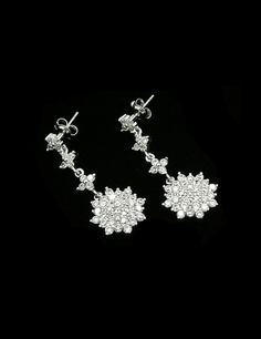 """Well appreciated by many at its first look and this jewelry further enriched to make it totally pleasant.  Brand: Fashion Jewelry New York  Product: Custom Made Fashion Drop Earrings - White Gold Rhodium  Price:  $22.00   Quick Overview Total Length: 1.86"""" / Beautiful Sparkling CZ Size: 2mm    Visit: http://fashionjewelrynewyork.com/earrings/custom-made-fashion-drop-earrings-white-gold-rhodium-es4371e.html"""