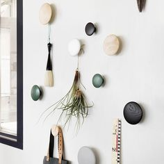 The Dots from Muuto are a series of coat hooks designed to be mounted and arranged on your wall decoratively. Muuto Dot hooks look as good on their