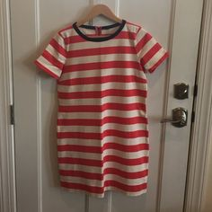 JCrew Coral and White Striped Shift Dress Super cute coral and white/cream striped shift dress!  Super comfy and versatile!  Good condition! J. Crew Dresses
