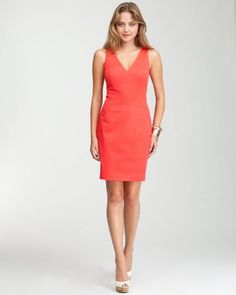 This Bebe cotton dress is simply classy. With waist sculpting seams and a v-neckline, this dress will give you a polished sophisticated look.