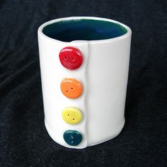 Teal Button White Handmade Ceramic Pottery Coffee Mug. $34.00, via Etsy.