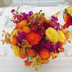 """A Vibrant Orange and Yellow Rose Centerpiece with Purple and Yellow Orchids--""""as is"""" $100.00 (can easily scale it down for budget and change flower types)"""