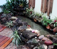 Backyard Pond Landscaping Small Gardens Landscaping Designs for a Backyard Pond Backyard Pond Landscaping Small Gardens. Landscaping designs that are going around or near a pond can be a little tri… Small Water Gardens, Fish Pond Gardens, Lake Garden, Garden Pool, Backyard Water Feature, Ponds Backyard, Pond Landscaping, Landscaping With Rocks, Pond Design