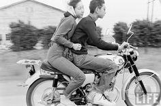 Couple on motorcycle. Japan. Undated