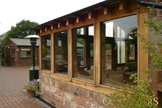 http://www.oakmasters.co.uk/products/sun-rooms-orangeries/project/oak-and-stone-sunroom-in-cheshire/