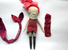 Lovely Little Lu doll stuffed with 100% natural wool! She has lovely pink cotton hair that can be gently styled as you like. Her face is hand stitched