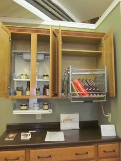 Cabinet set-ups include storage options that can be pulled out or even lowered. With the cabinet doors closed, it's just beautiful cabinetry.