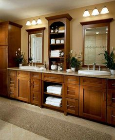 Bathroom with tons of storage by kraft maid via country living