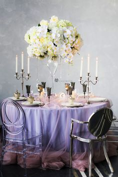 Pastel dusty rose and lavender wedding reception color schemes using tablecloths from CV Linens. Add tall flower centerpieces and candelabra candle holders for a sophisticated fairy tale wedding look to make your dream wedding come true on a budget! This elegant spring wedding reception decorations work for winter weddings, bridal showers, quinceaneras, and sweet 16 birthday party decorations. #lavenderweddingtheme #lavenderweddingideas #lavenderweddingcenterpieces #lavenderweddingflowers Pastel Wedding Centerpieces, Lavender Wedding Centerpieces, Lavender Wedding Theme, Butterfly Wedding Theme, Sweet 16 Centerpieces, Purple Wedding Decorations, Lavender Decor, Sweet 16 Decorations, Quinceanera Decorations