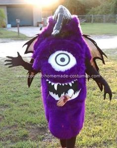 One eyed one horn flying purple people eater costume: For this costume I used a bowl for the eye, I attached it to fake purple fur, which I stuffed  with a pillow. To the eye I added eyelashes, and a iris.