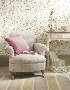 Leafy green wallpaper can transform a room with the help of a colourful cushion or two!