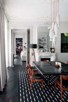 Black and white contrast interior styling with hanging fish lamp