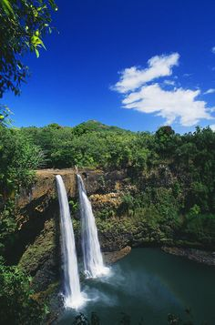 Wailua Falls, an 173-foot waterfall located in Kauai, Hawaii that feeds into the Wailua River.