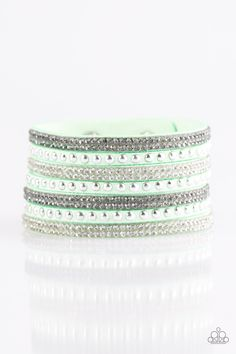 Victory Shine - Green Bracelet - $5  Shiny silver studs and rows of smoky and glittery white rhinestones are encrusted along strips of green suede, creating sassy shimmer around the wrist. Features an adjustable snap closure.  Sold as one individual bracelet.
