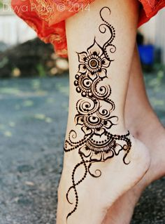 "Really like the ""flow"" of this tattoo -- it almost has a Spanish flamenco feel to it with the ""beads"" at the bottom."