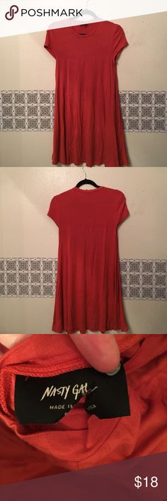 Nasty gal flowy casual dress short sleeve orange Nice burnt orange color dress by nasty gal, super cute casual dress with boots and thigh highs! Cute short cap sleeves, I wore only a couple times. I moved and have no closet space so need a posher to love it! Nasty Gal Dresses Mini