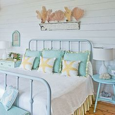 Beachy Bedroom Featuring Wrought Iron Painted Bed Breezy Curtains And Shell Display Above On Floating Shelf Love The Frame