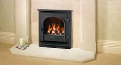With high efficiency technology Offering the familiar 'family look' of Yeoman stoves and the latest high-efficiency heating, the Darmouth is an inset convec . Inset Log Burners, Wall Fires, Gas Stove, Gas Fireplaces, Lounge, Home Appliances, Dartmouth, Stoves, Living Room
