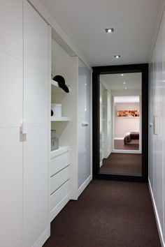 lovely walk through wardrobe cabinetry & space