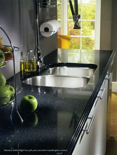 Silestone Night Mist. Love our Silestone counters in the kitchen. I think black for the bathroom would be perfect.
