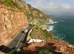Drive along Chapman's Peak to Cape Point The twenty-minute drive from Cape Town, Western Cape is surrounded entirely by mountains and the Atlantic Ocean. I Cape Town Stuff To Do, Things To Do, Atlantic Ocean, Cape Town, Live, My World, The Twenties, Mountains, Water