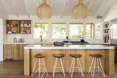 """modern raw-oak cabinetry and Caesarstone countertops; large-scale slatted-wood pendant lamps act as strikinghref=""""http://www.sunset.com/home/decorating/wall-art"""">art elements</a>.</p>  <p>More: <a href=""""https://www.sunset.com/home/home-tours/small-house-remodel"""" target"""
