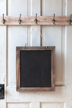 """Double-sided chalkboard with reclaimed wood frame. Hangs from jute rope. Dimensions: 18"""" x 20.5"""""""