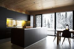 Open kitchen design of the chalet Lompolonmohkki, designed by Joarc Architects.