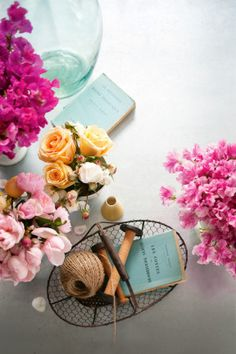 Create areas of floral interest by grouping small posies with favourite objects like old books and craft materials.