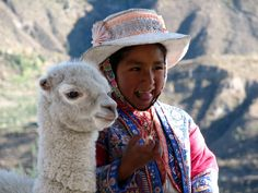 Melanie Russell spots a Peruvian girl with her llama