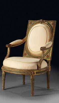 A pair of Louis XVI painted and parcel-gilt fauteuil a chassis