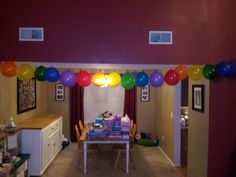 Rainbow balloon garland for a rainbow birthday party. Use a needle and thread to sew all the balloons together after they are blown up and tied