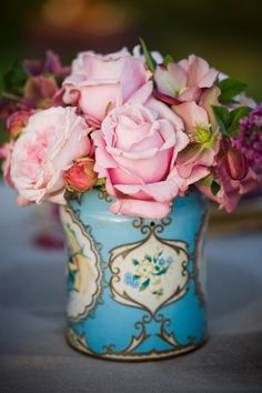 Freshly cut roses in an antique toleware cachepot