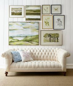 Chesterfield, green landscape wall gallery, vertical white plank walls and…