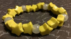 Check out this item in my Etsy shop https://www.etsy.com/listing/261354188/kandi-yellow-star-beads-white-glow-beads