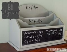 Bill organizer with a chalkboard. I could do this with pallet wood, a jigsaw or scroll-saw. I'll post when I've done it!
