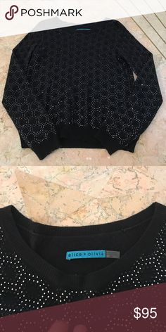 Alice + Olivia Embellished Crewneck Sweater Gorgeous black sweater with silver embellishment in a honeycomb pattern. Beautiful for the holidays or with a pair of jeans. All beading in tact. Alice + Olivia Sweaters Crew & Scoop Necks
