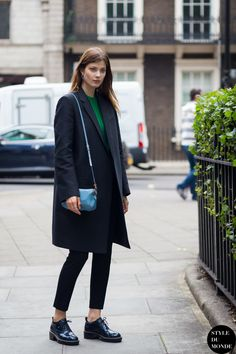 Larissa Hofmann in black outfit with green top and baby blue bag