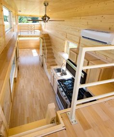This 30-foot tiny house is wrapped in shou sugi ban siding and the interior is finished with natural pine siding. Clerestory windows, large picture windows, and a full light front door provide an abundance of natural light.