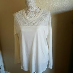 NWOT Cream Old Navy Mixed Media Long Sleeve Top NWOT Never Worn Cream Old Navy Mixed Media Long Sleeve Blouse Size M This blouse has really cute details including lace detail across top and shoulders rounded neckline side split hem and key hole accent in back  The front and sleeves are 100% Rayon and the back is sheer 100% Polyester Old Navy Tops Blouses