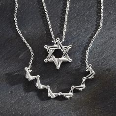 Pull apart necklace ~ A pendant of butterflies that forms a Star of David when it's closed.