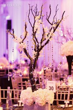glamorous vintage wedding centerpiece maznita branch with hanging crystals