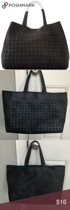 Black Studded Tote Bcortage Style Bag Used, in good condition. Edgy tote bag that has lots of room! Black faux leather with black studs rivets on the front of the bag. Similar style to Steve Madden Bcortage. Bags Totes