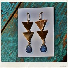 Atlanta artist (and Girls Preparatory School graduate) Courtney Weil creates cool & playful jewelry inspired by her love of travel. Kyanite teardrops hang below two brass triangles to create this lovely pair of earrings. Available at blue skies- $32.00