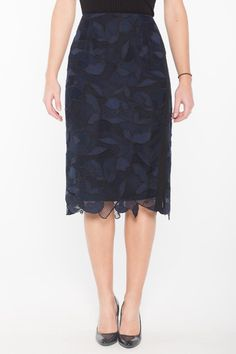 "A gorgeous high-waisted skirt from brand Grey by Jason Wu. This garment is fully lined and features a zip closure at back an uneven hem and a modest slit at left front. The lining of this skirt is black while the lace overlay is navy with black accents. Length measures 28"". This piece is designed to fall below the knee.  Lace Overlay Skirt by Jason Wu. Clothing - Skirts - Pencil Vail Colorado"