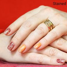 Geometric lines light up this orange-to-red ombre mixed-mani.