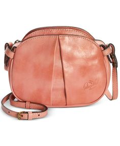 """Curvy contours and a slender strap lend irresistible appeal to this everyday crossbody bag from Patricia Nash. 